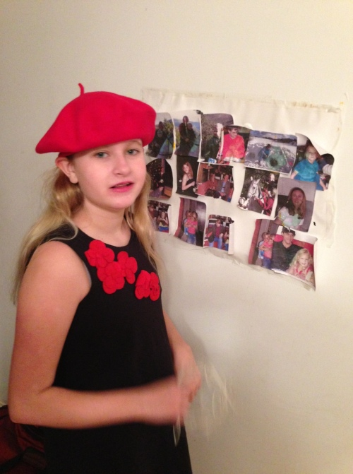 Emma showing off her new red beret and her new art work (a collage of relatives).
