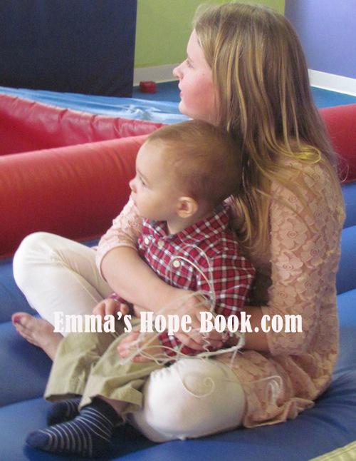 Emma holding Teddy